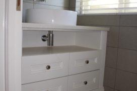 Vanity bathroom cupboards by Woodhouse Kitchens