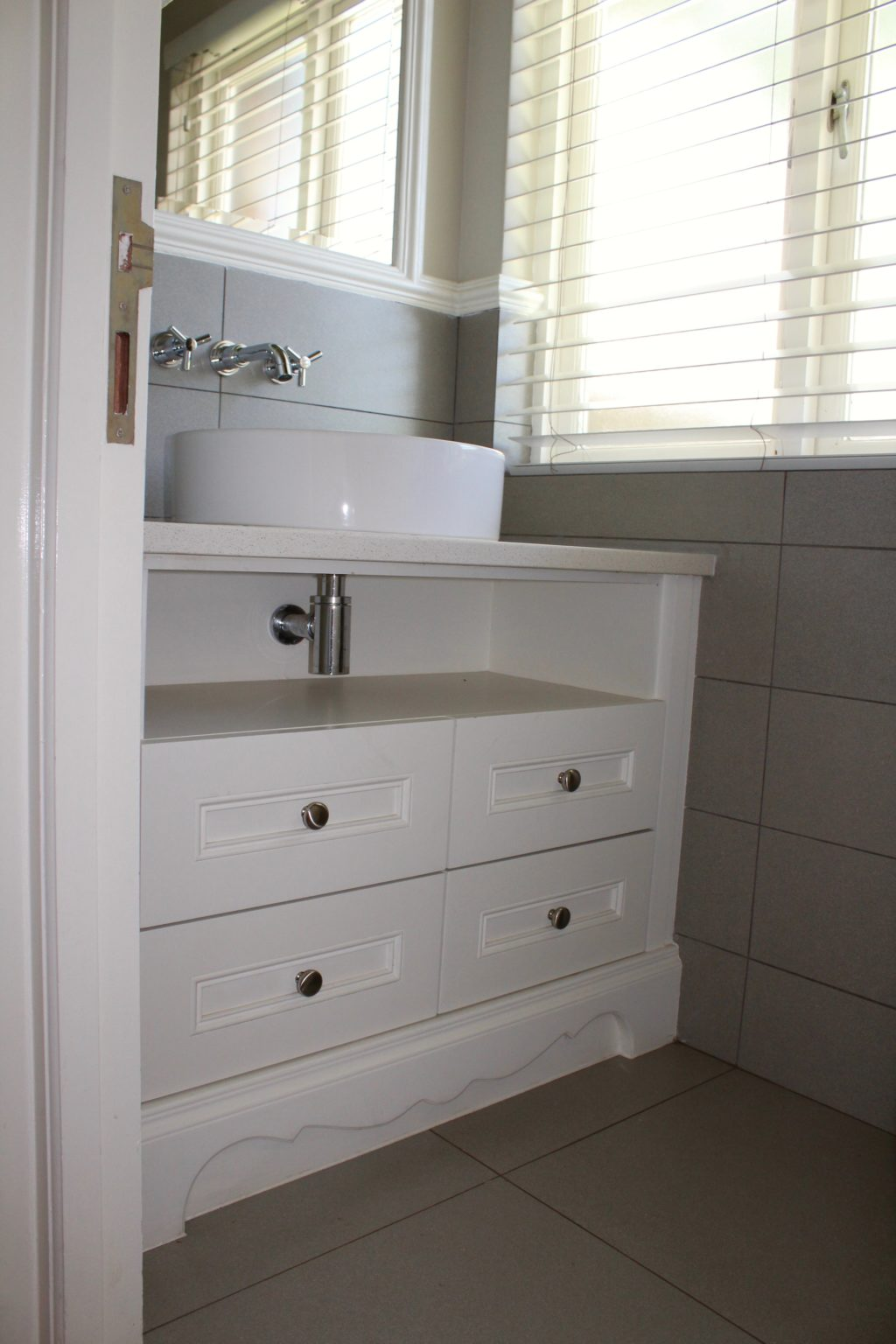 Bathroom vanity cupboard and basin by Woodhouse Kitchens and Cupboards