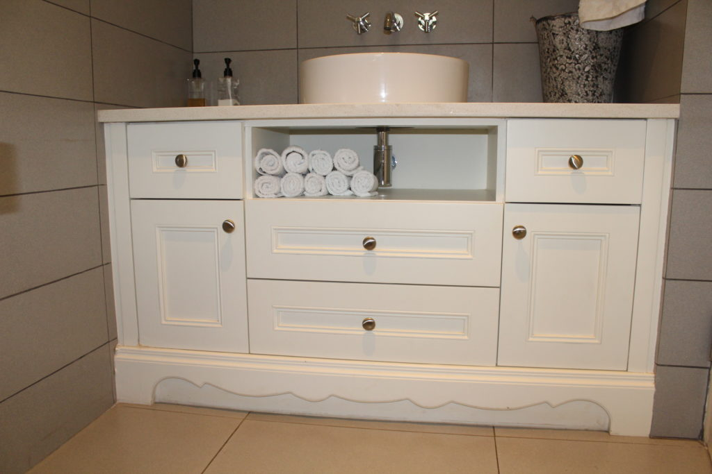 Vanity bathroom cupboard by Woodhouse Kitchens and Cupboards