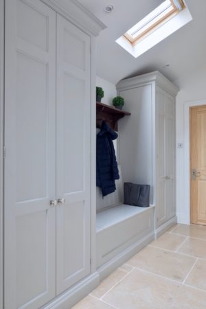 Tall cupboards in a Mudd room by Woodhouse