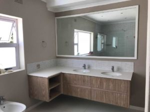 Oak floating vanity cupboards by Woodhouse
